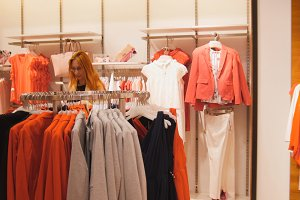 A woman chooses a suit in a women's clothing store