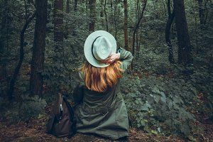 Young girl enjoy the forest view