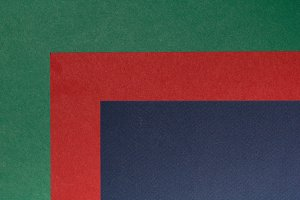 Abstract composition of green, red and blue paper