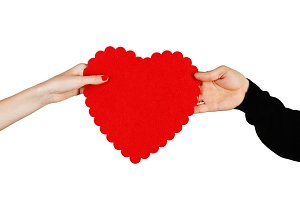 Couple in love holding a red heart