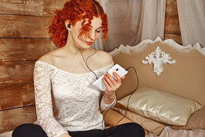 Redhead girl listening to music