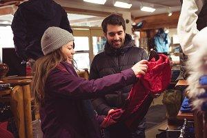 Couple shopping in a clothes shop