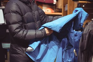Man shopping in a clothes shop