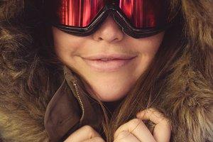 Woman in fur coat and ski goggles