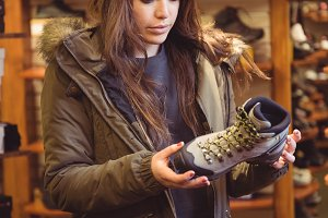 Woman selecting shoe in a shop