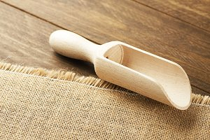 Wooden spoon on brown cloth.
