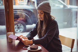 Woman using digital tablet in restaurant