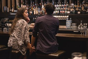 Romantic couple sitting at bar counter