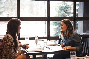 Friends sitting in a restaurant
