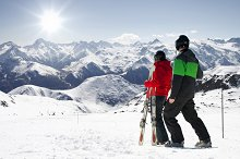 Couple looking in snowy mountain ski
