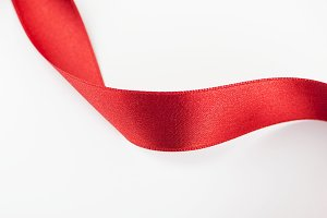 Abstract heart with red fabric ribbon. Isolated. Copy space. Horizontal shoot.