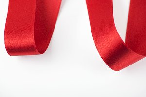 Abstract shapes with red fabric ribbon. Isolated. Copy space.