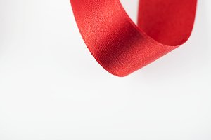 Abstract shapes with red fabric ribbon. Isolated. Background. Copy space.