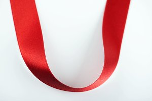 Background of abstract shapes with red fabric ribbon. Isolated. Copy space.