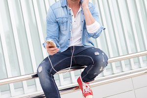 Attractive guy listening music