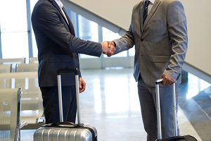 Business people shaking hand in waiting area