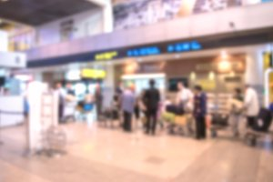 blurred of Traveler Check in airport