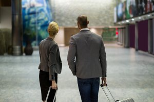 Rear view of businesspeople with luggage