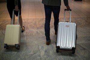 Businesspeople walking with luggage