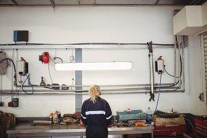 Female mechanic working in repair garage