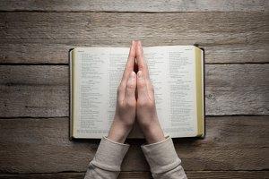 Reading Bible in dark