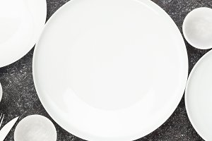 Table setting. Plates and cutlery.