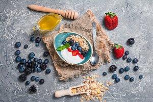 Baked granola with  honey, yogurt and berries