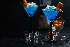 Blue cocktail in martini glasses