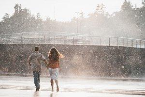 Couple running in the rain