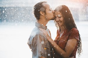 Lovers in the rain kissing