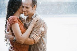 Couple hugging in the rain