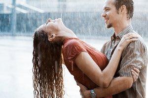 Couple having fun in the rain