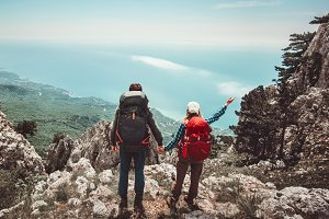 Happy Couple enjoying mountains view
