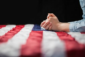Praying over american flag