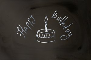 Chalk inscription happy birthday cupcake with candle