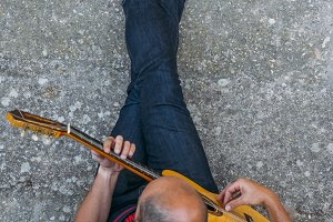 Man playing guitar seen from above