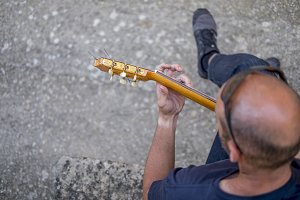 Hand on guitar mast