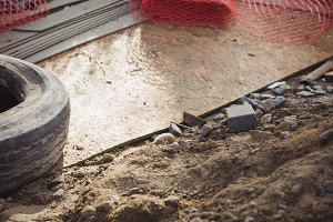 Metallic net and tyre at construction site