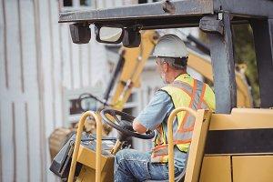 Man operating bulldozer