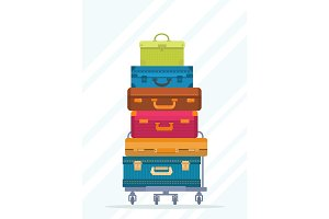 Travel colorful stacked suitcases isolated