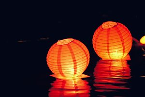 Circle floating lighting Lanterns on river at night - romantic festival