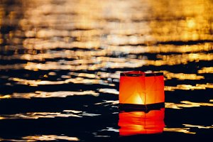 Floating lighting water Lanterns on river at night