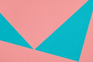 Abstract composition of blue and pink paper