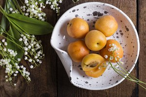 Fresh apricots on wooden table