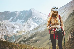 Woman hiking at rocky mountains