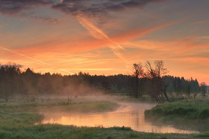 Colorful morning sky over small rive