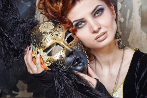 Red-haired lady and mask