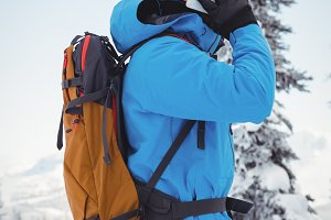 Skier talking on mobile phone