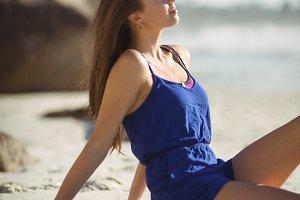 Beautiful woman relaxing on beach