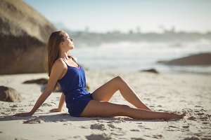 Beautiful woman relaxing on beach